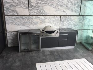 Full aluminium cabinets with titanium grey doors, and granite bench tops Sunco 2 Door fridge and a Weber Q BBQ. Location: